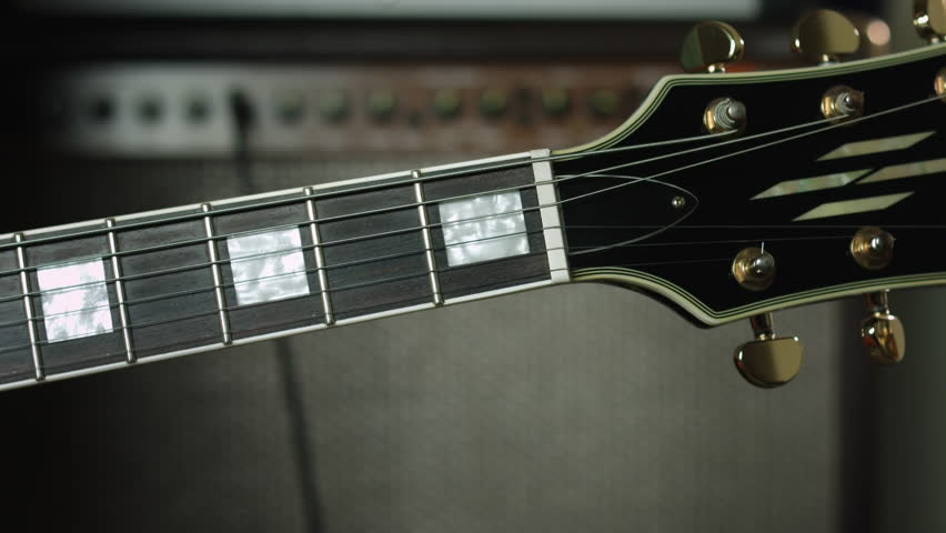 Stock video of playing em chord on six string | 21402214 | Shutterstock