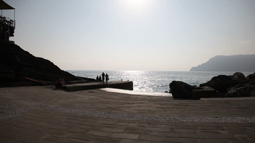 A dock in Vernazza, Cinqueterre, Liguria, with people walking around.