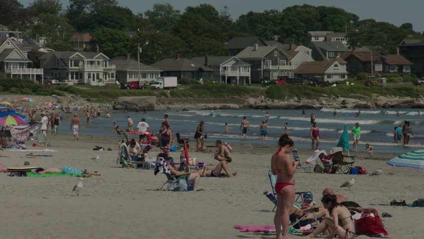 Day Sunbathers Busy Sandy Beach Eastern Small Waves People Water See Houses