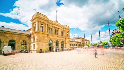 Mainz, Germany - June 22, 2016: Mainz Central Train Station showing pedestrians and public transport interchange by day in Timelapse