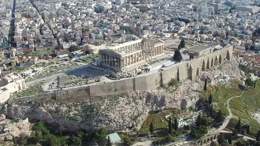 Aerial drone bird view close up flight around the Acropolis of Athens ancient citadel located on rocky outcrop showing Parthenon very famous tourist attraction in Europe Greece nice European city 4k