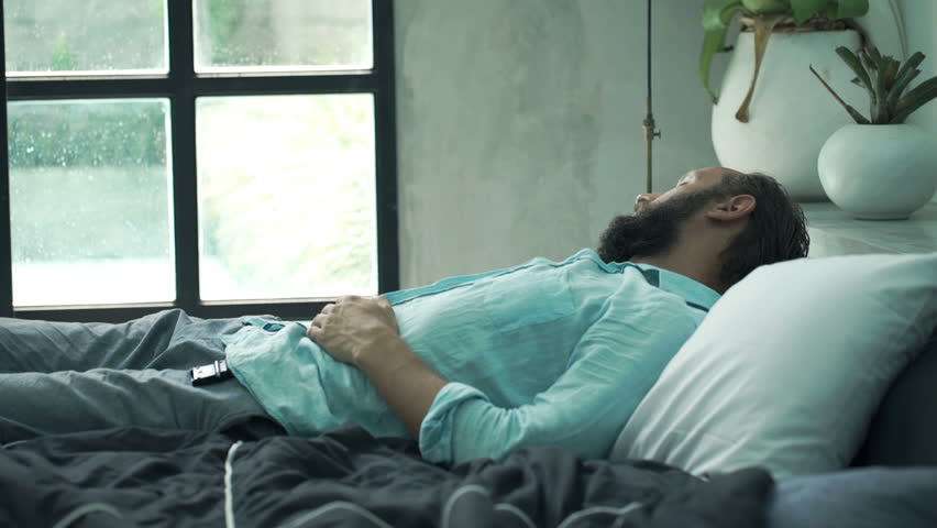 Young man waking up from sleep lying in bed at home  #21483739