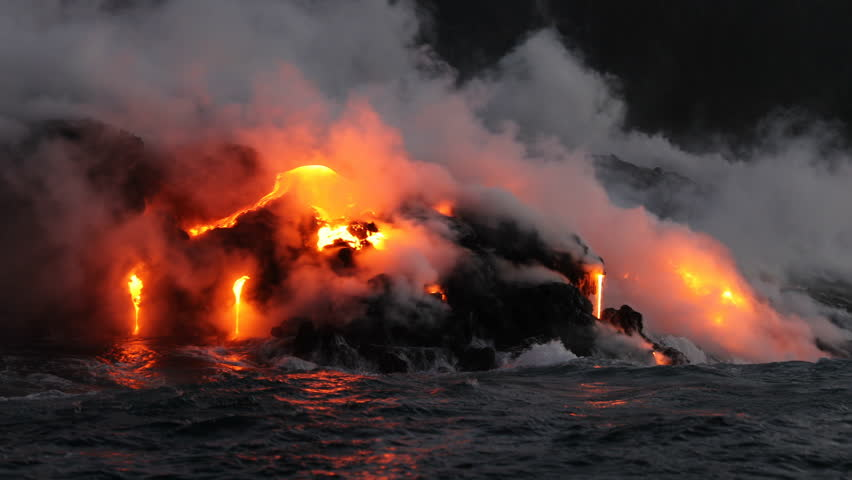 Hawaii Lava ocean close up - Lava running in the ocean from Kilauea volcano, Hawaii. Lava stream seem from lava boat tour flowing from volcanic eruption on Big Island, USA. Dawn Slow motion. Year 2016