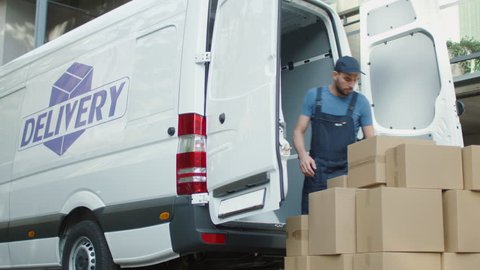 Young Mover Loads his Commercial Vehicle with Large Cardboard Boxes. Shot on RED Cinema Camera in 4K (UHD).