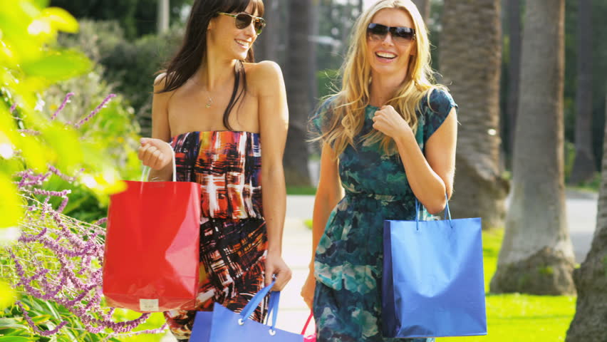 Young girlfriends laughing on a fun day of shopping | Shutterstock HD Video #2153279