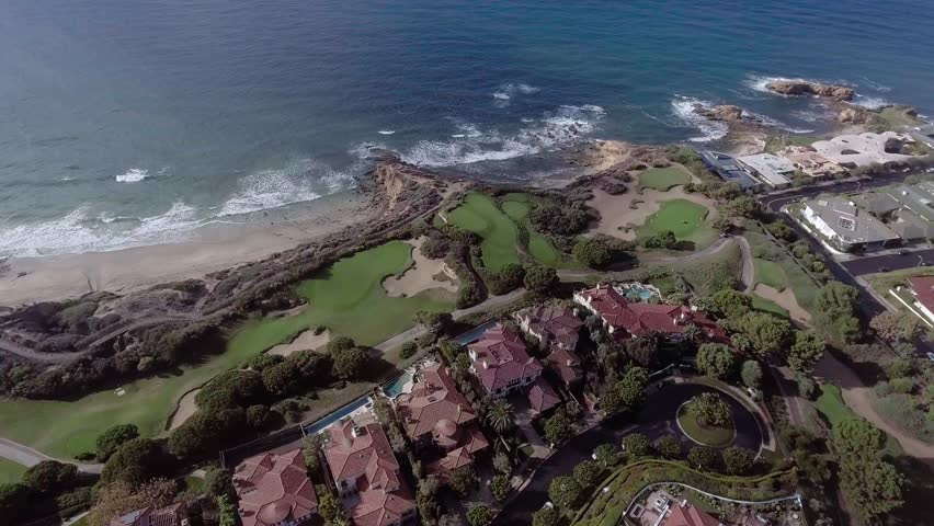 Aerial View of Cliff side homes in Pelican Hill Golf Course located on the cliffs of Newport Beach, adjacent to Crystal Cove State Park
