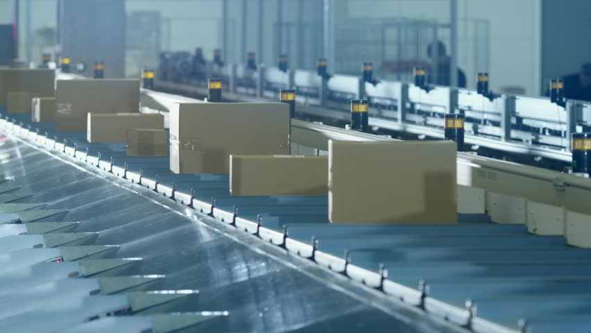 Parcels are Moving on Belt Conveyor at Post Sorting Office. Shot on RED Cinema Camera in 4K (UHD)