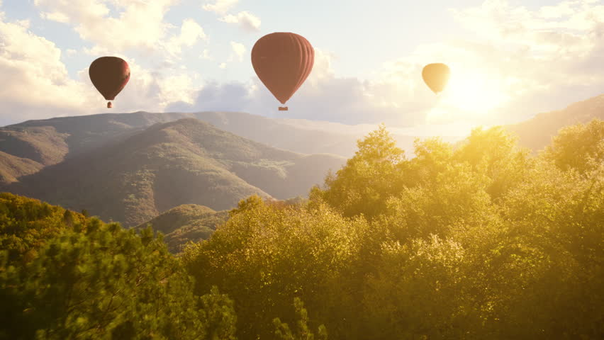 Hot Air Baloons Aerial Drone Flight Over Beautiful Autumn Forrest at Sunet Mountains Beautiful Landscape Background Sunny Vacation Travel Destination Concept