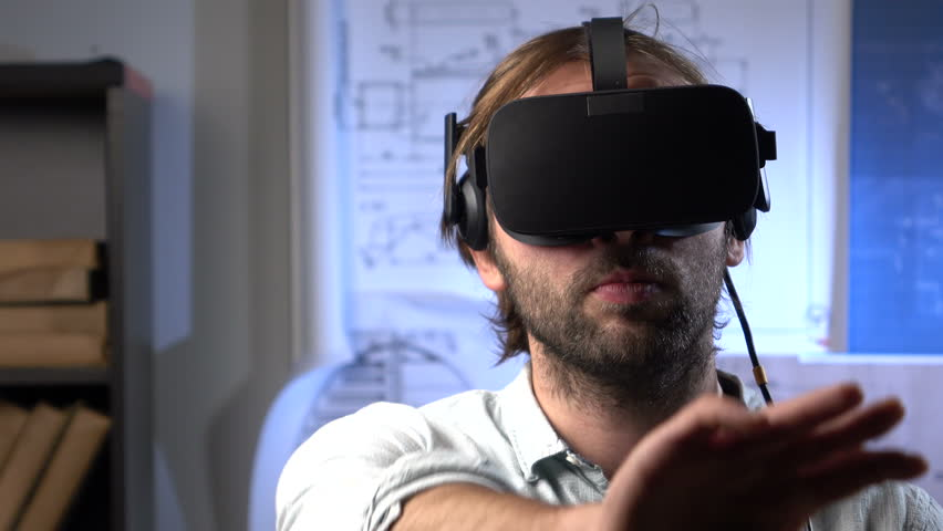 Man uses a virtual reality glasses in the office.