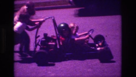 SAN DIEGO 1981: kid is driving a nascar on the street with a help of relatives