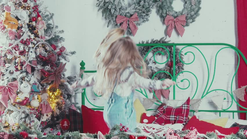 Slow Motion. A Cute Little Girl With Long Blond Hair Jumping And ...