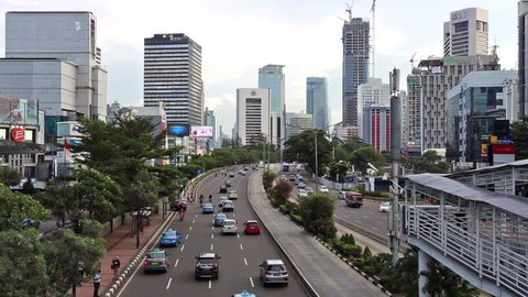 JAKARTA, INDONESIA - NOVEMBER 2, 2016: Traffic rush through the main street in Jakarta business district, Jalan Sudirman, in Indonesia capital city. Jakarta is South East Asia largest city.