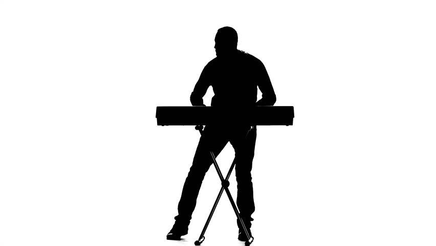 Man Dj Playing Electronic Keyboards. Silhouette. Slow ...