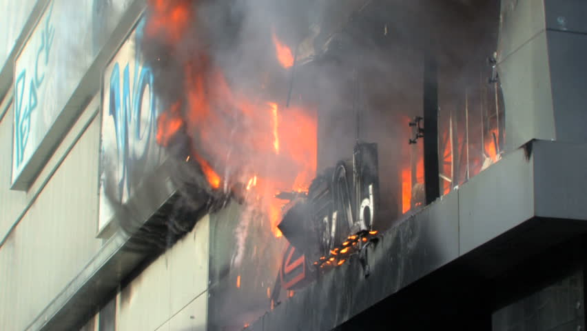 "BANGKOK, THAILAND - APRIL 19: Zen Central Department Store engulfed in smoke and flames during ""Red Shirt"" violent protest riots on April 19, 2010 in Bangkok, Thailand"