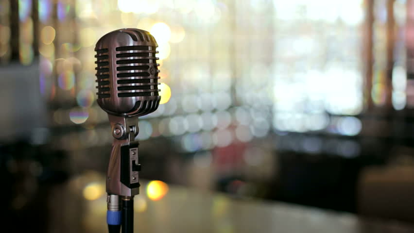 Retro microphone on stage in restaurant. Blurred background ...