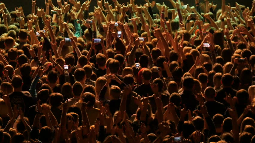 A crowd of people at a rock concert. Fans gather in front of the performance of a rock band. | Shutterstock HD Video #21709609
