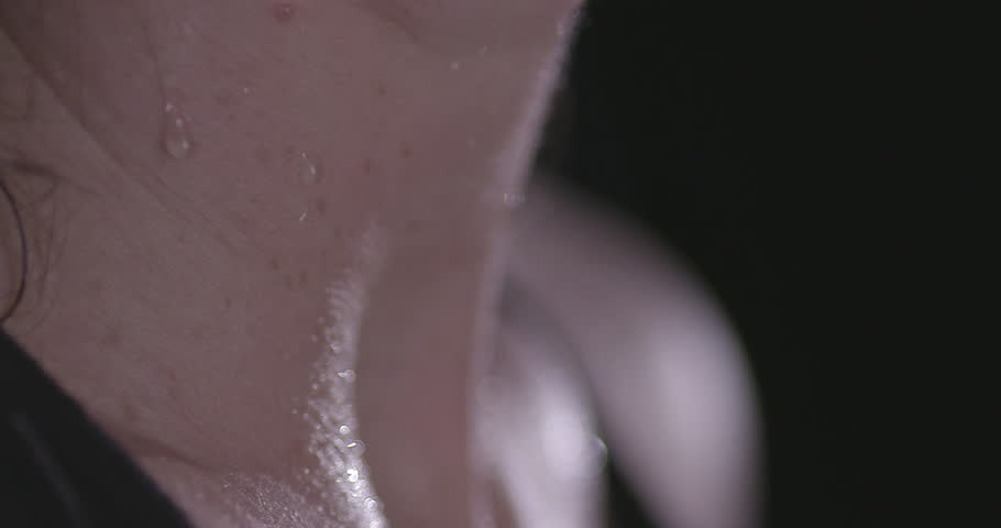 FEMALE BOXER WORKING OUT. Slow motion Extreme close up shot. A woman's mouth, breathing Heavily. Camera pans down #21741709