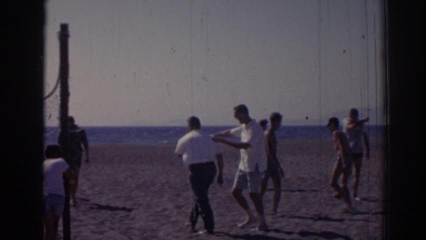 IZMIR TURKEY 1962: businessman cajoled into playing beach volleyball. #21745159