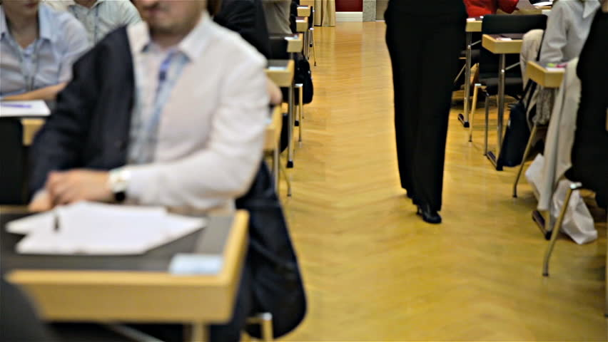 High heels walking woman in middle of classrom close up on legs. Dolly slide between conference room tables with female legs walking towards camera.   Shutterstock HD Video #21761809