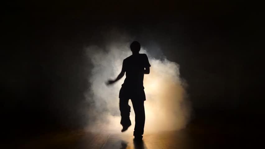 Dancer in the smoke in the dark. | Shutterstock HD Video #21777733