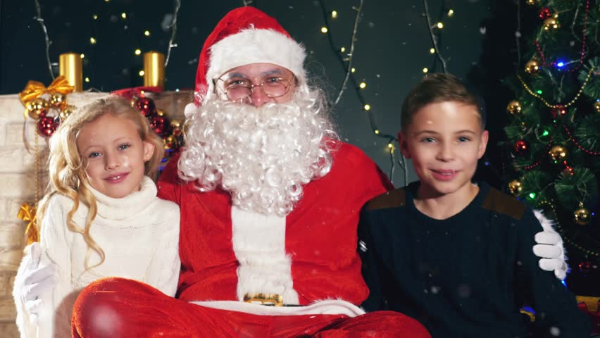 santa and kids near the decorated christmas tree wishes list 4k stock video clip - Santa And Kids