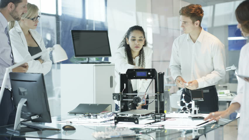 4K Scientific research engineers working in lab with computer and 3D printer (UK-Oct 2016) | Shutterstock HD Video #21852799