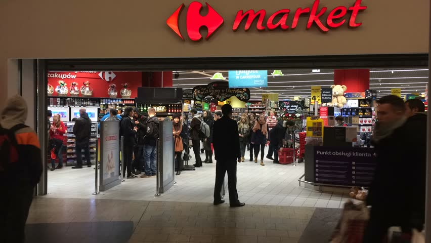 Warsaw,Poland. 3 December 2016.Carrefour  with customers passing and entering. Golden Tarraces.