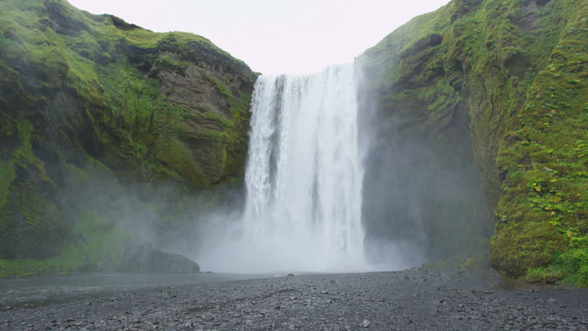 Iceland Waterfall Skogafoss in Beautiful Icelandic Landscape. Famous tourist attraction and natural landmark destination on the ring road. RED EPIC SLOW MOTION.