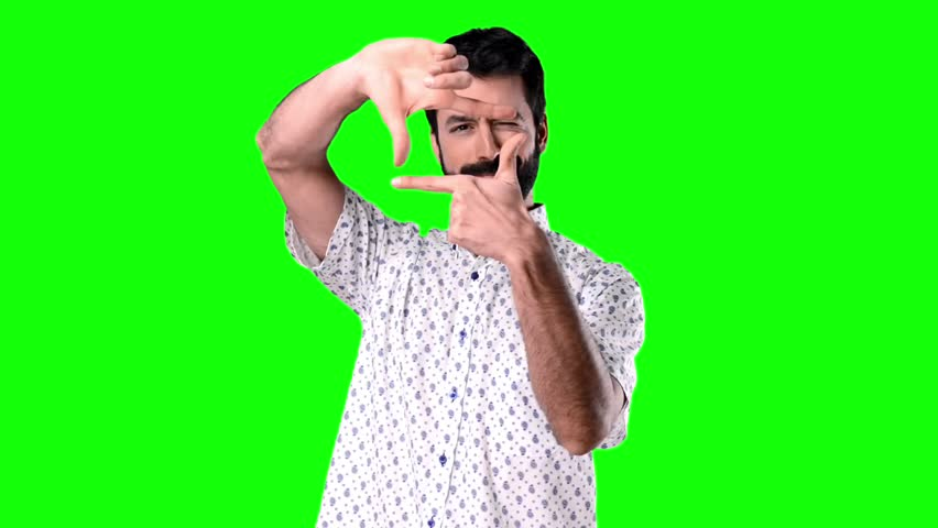 Man focusing with his fingers on green screen chroma key   Shutterstock HD Video #21939259