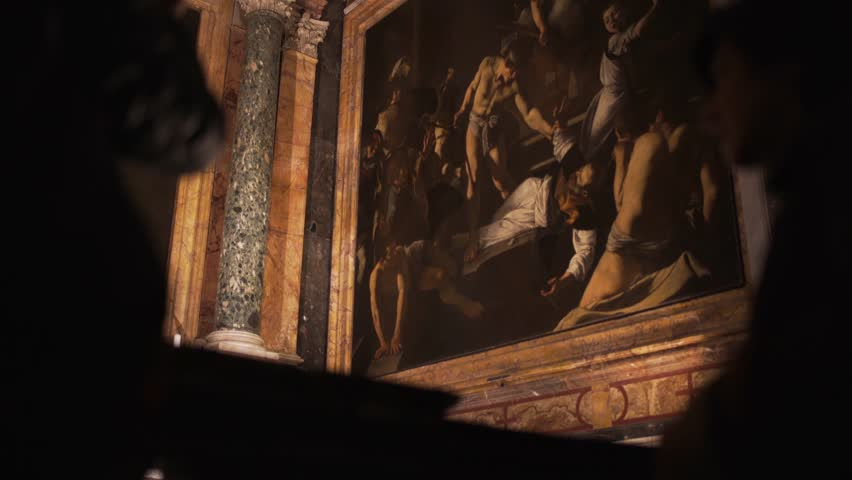 ROMA - NOVEMBER 27, 2016: tourists looking at a famous painting of Caravaggio italian painter in the San Luigi dei Francesi church in Rome.