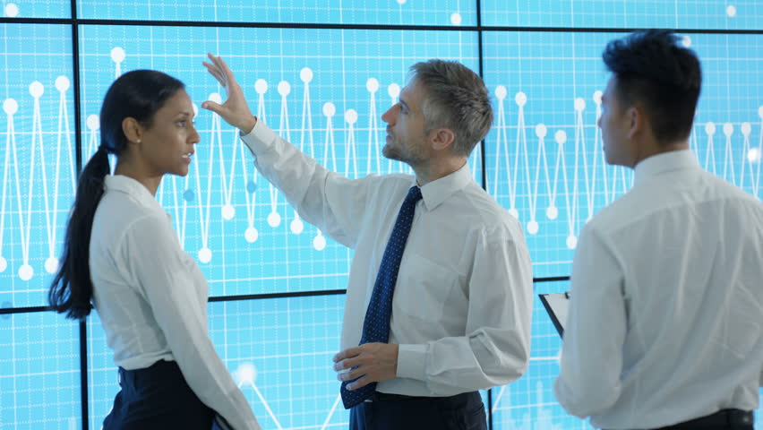 4K Business team in modern office, looking at video wall with graphs and data (UK-Oct 2016) | Shutterstock HD Video #21992068