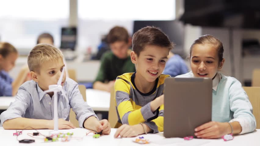 Education, science, technology, children and people concept - group of smiling kids or students with tablet pc computer programming electric windmill toy at robotics school lesson | Shutterstock HD Video #22015498