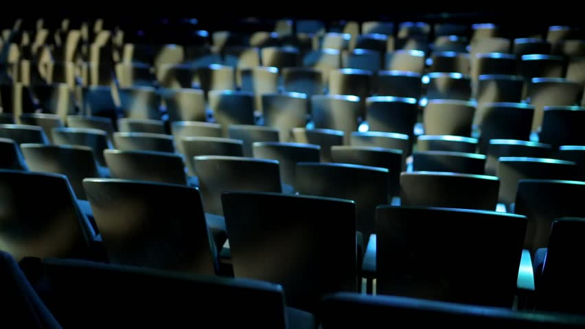 Empty theater auditorium or cinema with dark blue or black seats. Modern cinema auditorium with 3d glasses and many rows of seats. Dark movie theatre ready for projection. #22028929