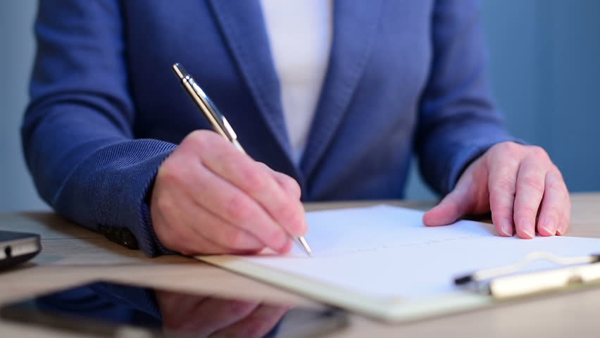 Businesswoman signing business contract agreement at office desk | Shutterstock HD Video #22046149