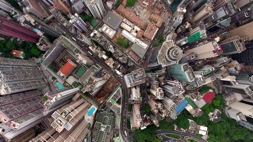 Top view aerial video of corporate skyscrapers tower in populous downtown of Hong Kong business district, development contraction and transportation infrastructure. Can be used for advertising or film | Shutterstock HD Video #22050619