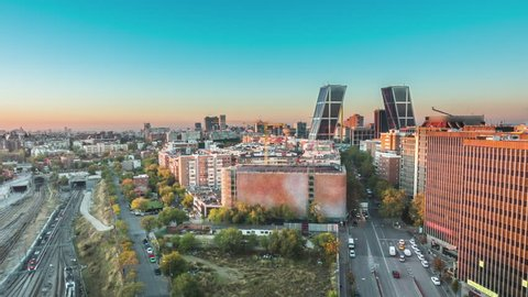 madrid skyline aerial view timelapse from night to day sun lighting the city