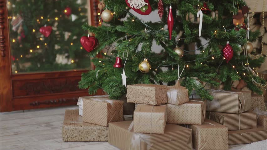 Close Up Shot Of Christmas Presents And Gifts Under New Year Tree HD