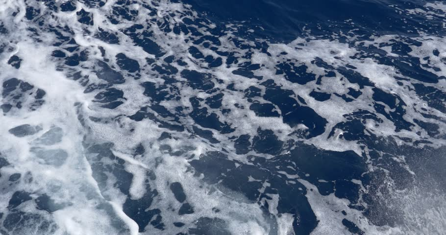 Trail of foamy sea waves splashing and crawling at high speed over the sea water surface, caused by a powerful motorboat engine 45    Shutterstock HD Video #22097338