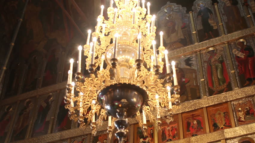 Chandelier and icons of saints in church