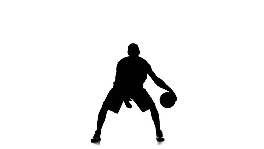 basketball player fills the ball. slow motion. silhouette. white