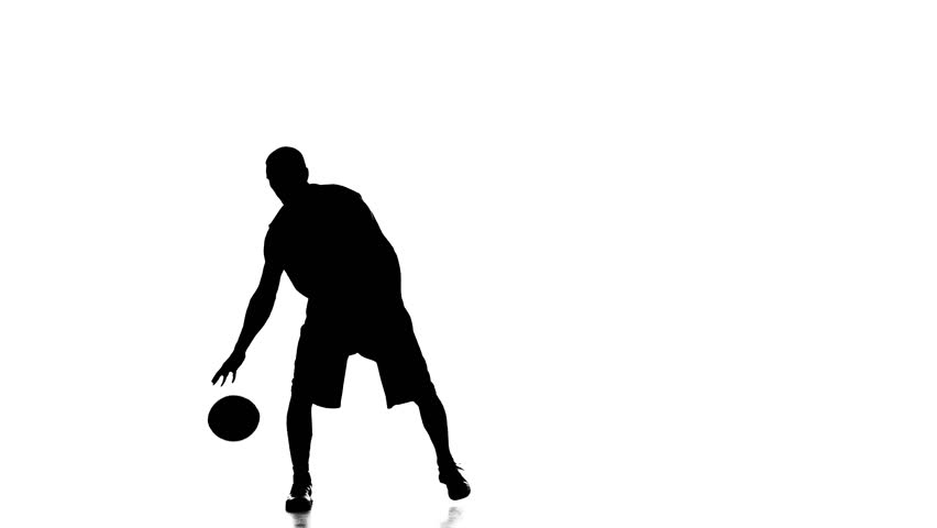 Boy basketball player skillfully handles the ball. Silhouette. White background