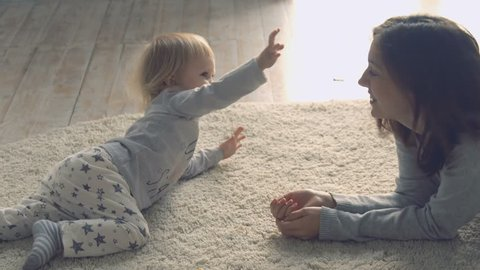 Mother plays with daughter on the floor