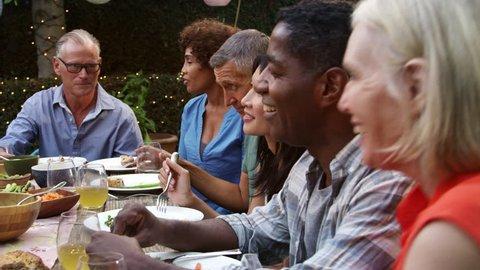Mature Friends Enjoying Outdoor Meal In Backyard Shot On R3D