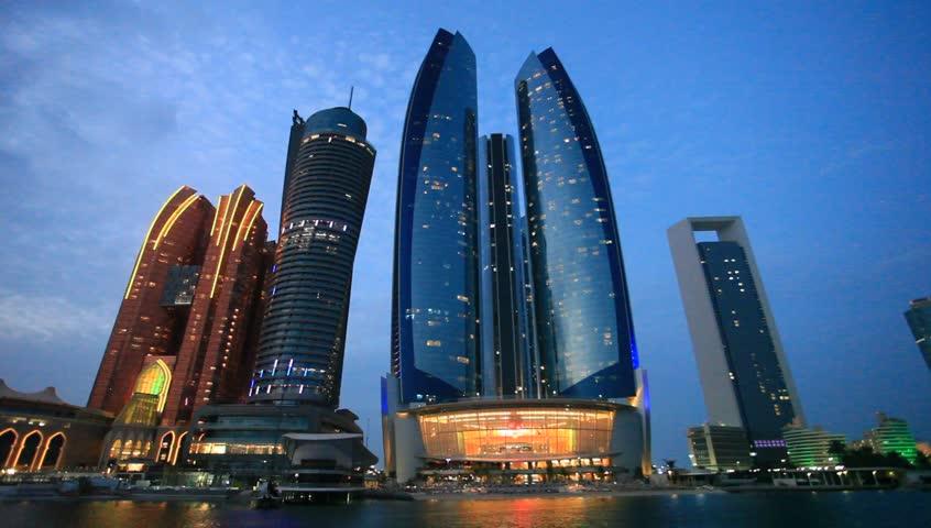 ABU DHABI, UAE - NOV 25, 2016: The Etihad Towers in Abu Dhabi illuminated at night. United Arab Emirates, Middle East