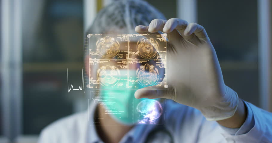 A physician, surgeon, examines a technological digital holographic plate represented the patient's body, the heart lungs, muscles, bones. Concept: Futuristic medicine, the human body, and the future. #22212229