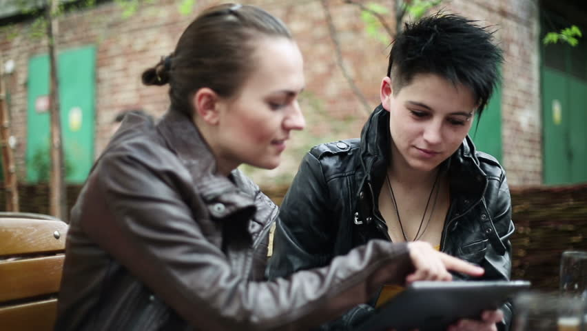 Young college students using a tablet computer, stabilized shot