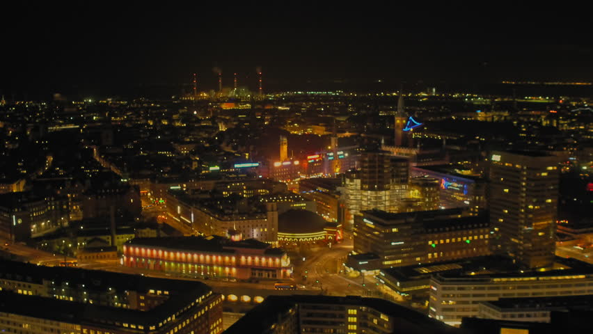 WS AERIAL Drone shots of city at night / Copenhagen, Denmark