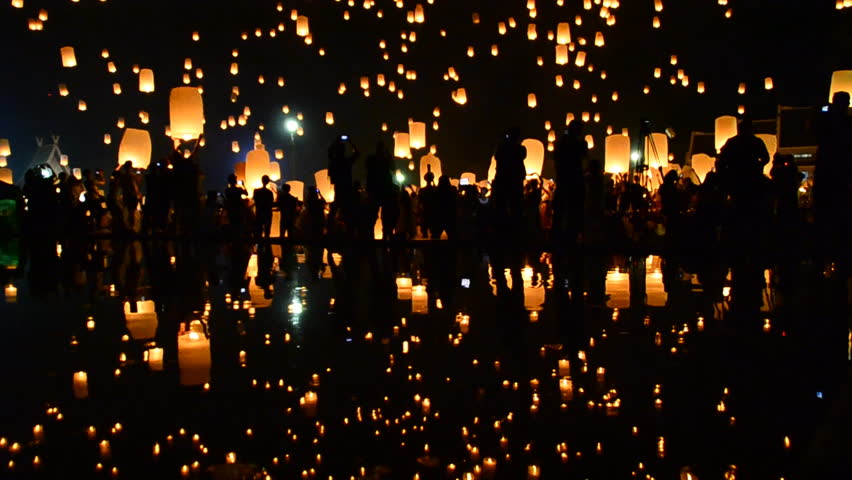 Many Sky Fire Lanterns Floating Up To The Sky In Yee Peng Lanna International 2016 And Reflection on Water Landmark Destination Travel Of Chiang Mai, Thailand (tilt up)