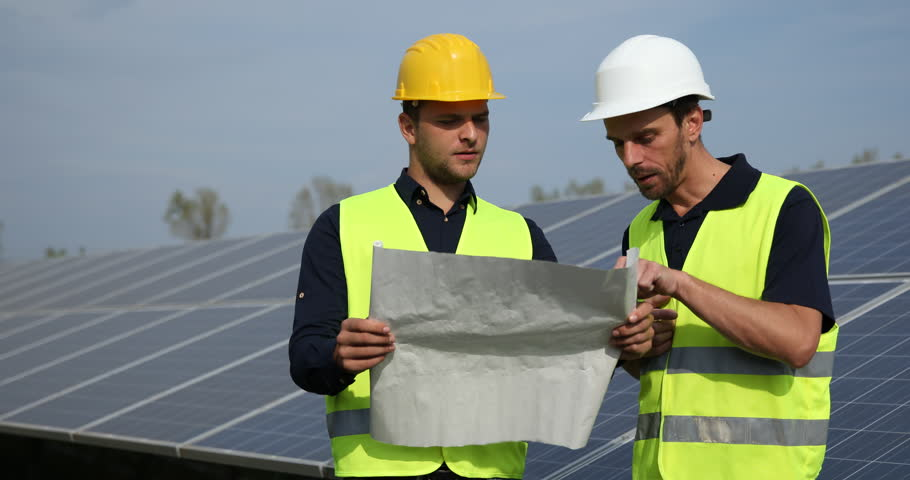 Engineer Men Analyzing Scheme Plan Talk and Inspect Solar Panels Industrial Area. Ultra High Definition, UltraHD, Ultra HD, UHD, 4K, 2160P, 4096x2160