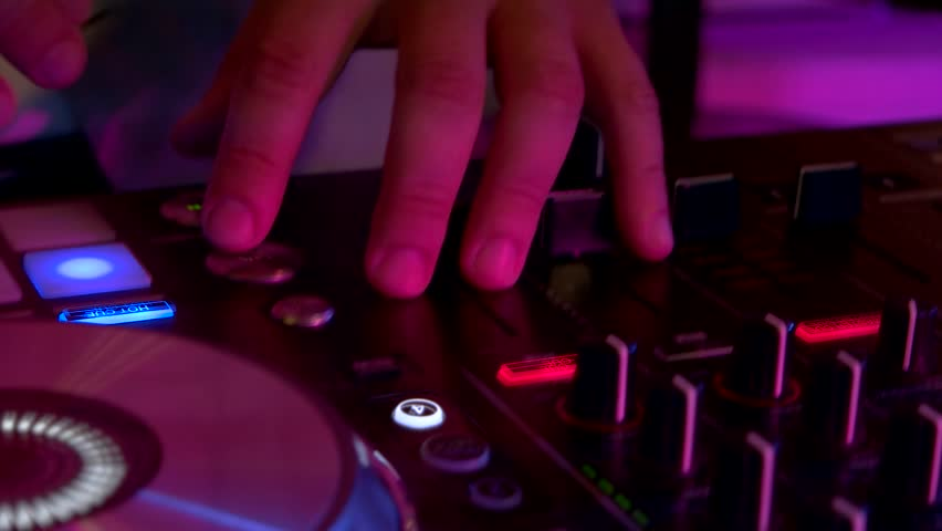 Dj mixer and man's hands. Knobs and buttons. The newest tracks. | Shutterstock HD Video #22373689